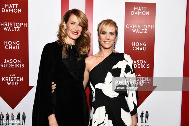 Laura Dern and Kristen Wiig attend the premiere of Paramount Pictures' 'Downsizing' at Regency Village Theatre on December 18 2017 in Westwood...