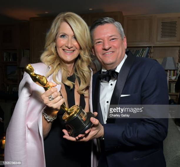 Laura Dern and Netflix Chief Content Officer Ted Sarandos attend the 2020 Netflix Oscar After Party at San Vicente Bugalows on February 09, 2020 in...