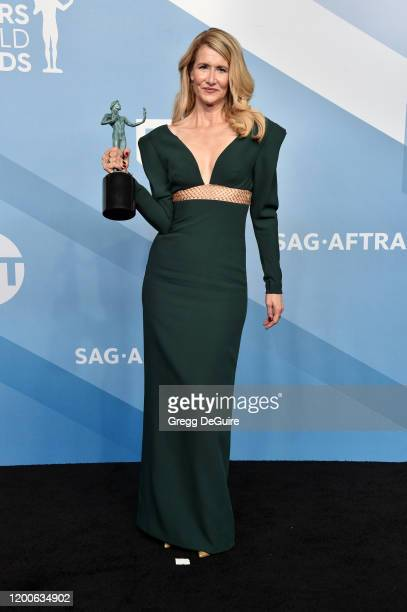Laura Dern poses in the press room with the trophy for Outstanding Performance by a Female Actor in a Supporting Role during the 26th Annual Screen...