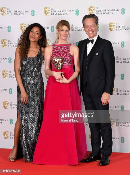 Laura Dern with the Best Supporting Actress award poses with Naomie Harris and Richard E Grant in the Winners Room during the EE British Academy Film...