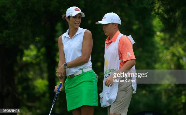 Laura Diaz and her son and caddie Cooper Diaz are seen during the second round of the ShopRite LPGA Classic Presented by Acer on the Bay Course at...
