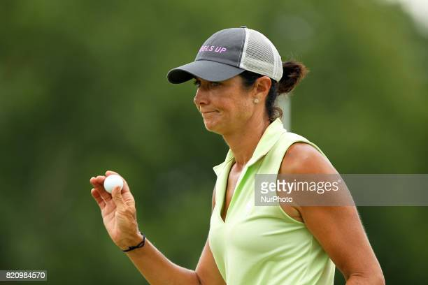 Laura Diaz of the United States acknowledge the gallery on the 18th green during the third round of the Marathon LPGA Classic golf tournament at...