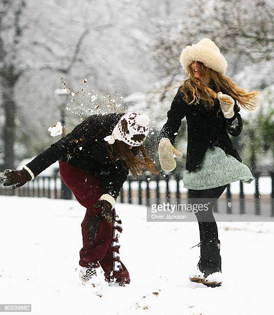 Laura Dibb from Canada and Parker Kegel from the United States make the most of the snow in Hyde Park on April 6 2008 in London England Snow fell...