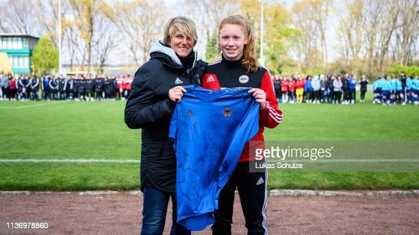 Laura Dick of Baden is honored by Silke Rottenberg as best goalkeeper of the U16 Women's Federal Cup at Sport School Wedau on April 14 2019 in...