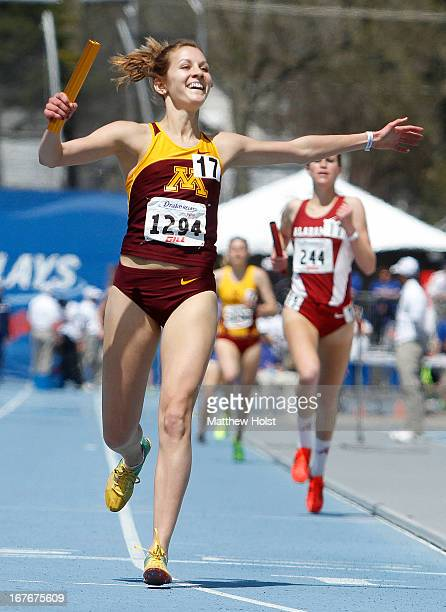 Laura Docherty, of the Minnesota Gophers, celebrates after anchoring a victorious team in the Women's Distane Medley at the Drake Relays, on April...