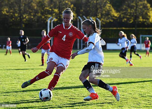 Laura Donhauser of Germany is challenged by Olivia Bergmann of Denmark during the International Friendly match between U16 Girl's Germany and U16...