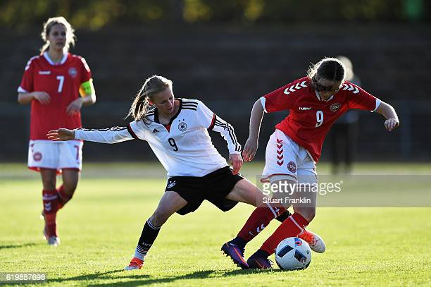 Laura Donhauser of Germany is challenged by Sarah Sundahl of Denmark during the International Friendly match between U16 Girl's Germany and U16...