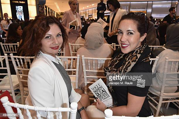 Laura Doux and Deborah Soares attend the Talents Fashion show during the Vogue Fa shion Dubai Experience 2015 at The Dubai Mall on October 29 2015 in...
