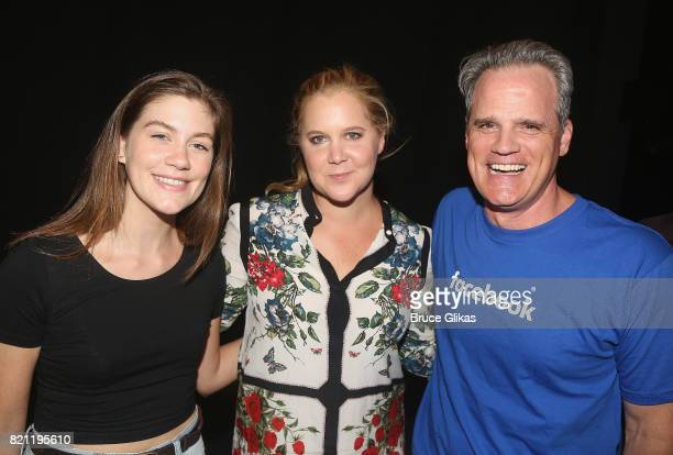 Laura Dreyfuss Amy Schumer and Michael Park pose backstage at the hit musical 'Dear Evan Hansen' on Broadway at The Music Box Theatre on July 22 2017...