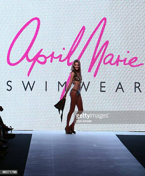 Laura Dundovic showcases designs by April Marie during the Swim Group Collection Show on the catwalk at the Overseas Passenger Terminal, Circular...