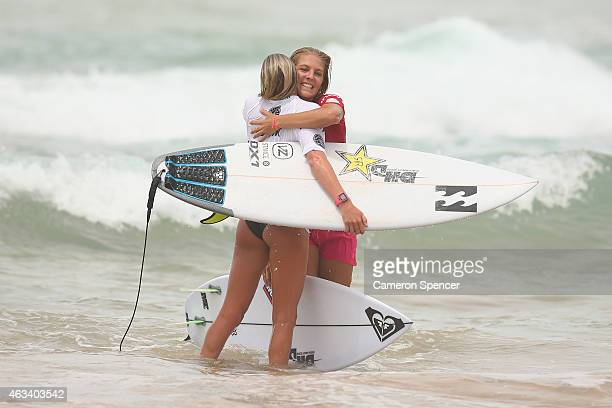 Laura Enever and Stephanie Gilmore of Australia embrace following their women's heat during the Australian of Surfing on February 14 2015 in Sydney...
