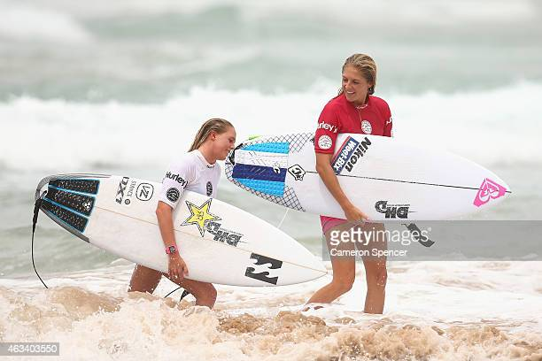 Laura Enever and Stephanie Gilmore of Australia talk following their women's heat during the Australian of Surfing on February 14 2015 in Sydney...