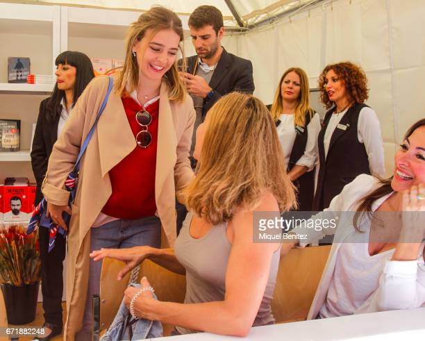 Laura Escanes talking with Gemma Mengual and Carme Barcelo during 'Sant Jordi's Day' 'Saint George's Day' at Plaa Catalunya on April 23 2017 in...