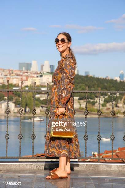 Laura Fantacci poses with Mehry Mu bag during in Balat tour on November 02, 2019 in Istanbul, Turkey.