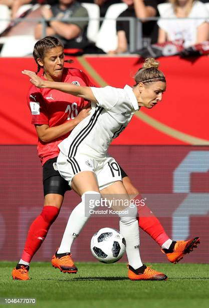 Laura Feiersinger of Austria fouls Svenja Huth of Germany during the International friendly match between Germany Women and Austria Women at Stadion...