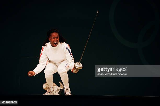 Laura Flessel from France reacts during the women's individual epee semifinal at the 2000 Olympics