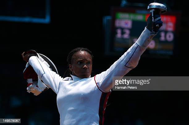 Laura FlesselColovic of France celebrates after a point against Courtney Hurley of the United States during the Women's Epee Individual Fencing round...