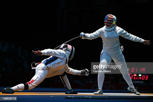 Laura FlesselColovic of France competes against Courtney Hurley of the United States during the Women's Epee Individual Fencing round 32 of on Day 3...