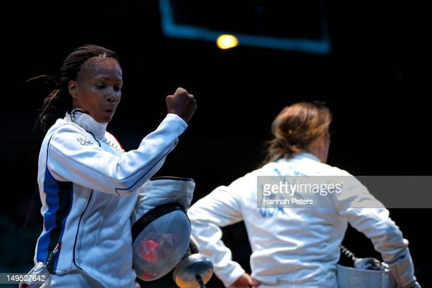 Laura Flessel-Colovic of France reacts after a point against Courtney Hurley of the United States during the Women's Epee Individual Fencing round 32...