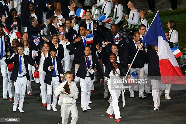 Laura FlesselColovic of the France Olympic fencing team carries her country's flag during the Opening Ceremony of the London 2012 Olympic Games at...