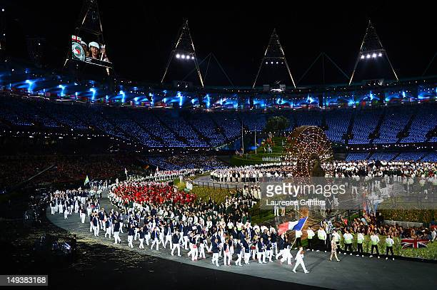 Laura Flessel-Colovic of the France Olympic fencing team carries her country's flag during the Opening Ceremony of the London 2012 Olympic Games at...
