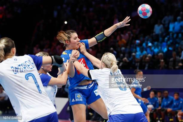 Laura Flippes of France is trying to shoot the ball against Polina Kuznetsova and Anna Sen of Russia during the EHF Women's Euro 2018 Final match...