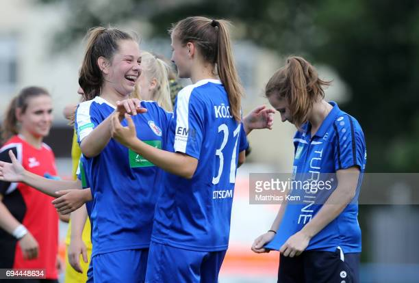 Laura Fluegge of Potsdam jubilates with team mate Melissa Koessler after winning the B Junior Girl's German Championship semi final match between...