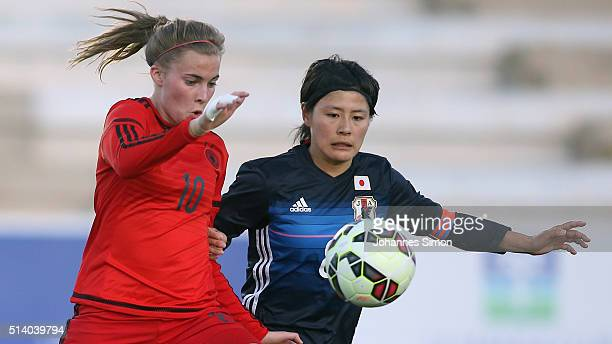 Laura Freigang of Germany and Hikaru Naomoto of Japan fight for the ball during the women's U23 international friendly match between WU20 Germany and...
