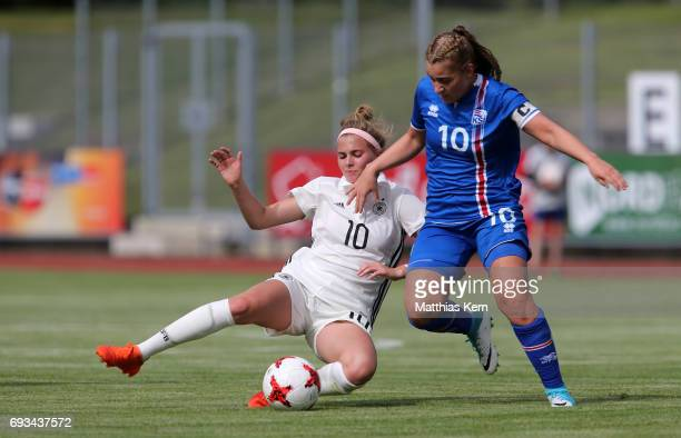 Laura Freigang of Germany battles for the ball with Andrea Mist Palsdottir of Iceland during the U19 women's elite round match between Germany and...