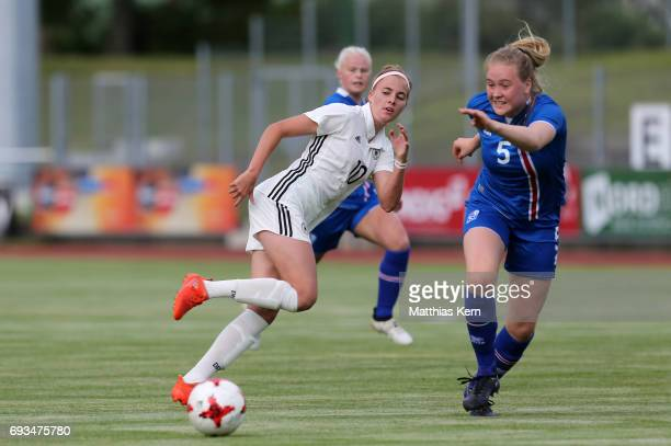 Laura Freigang of Germany battles for the ball with Mist Thormodsdottir of Iceland during the U19 women's elite round match between Germany and...