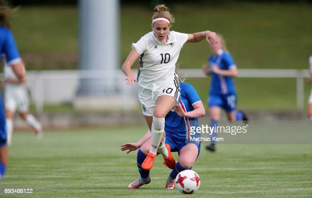 Laura Freigang of Germany battles for the ball with Selma Sol Magnusdottir of Iceland during the U19 women's elite round match between Germany and...