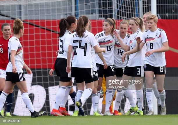 Laura Freigang of Germany celebrate with her team mates after she scores the equalizing goal during the Women's International Friendly match between...