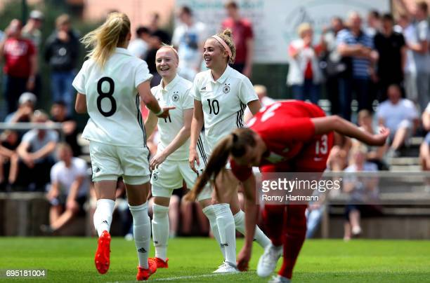 Laura Freigang of Germany celebrates after scoring her team's fifth goal with Anna Gerhardt and Kim Fellhauer of Germany during the U19 women's elite...
