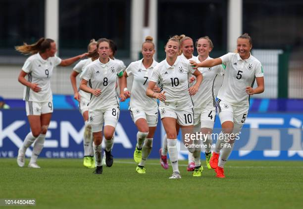 Laura Freigang of Germany celebrates with her team mates after scoring her sides second goal during the FIFA U20 Women's World Cup France 2018 group...