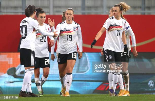Laura Freigang of Germany celebrates with Lina Magull Dzsenifer Marozsan and Lena Lattwein after scoring her sides third goal during the UEFA Women's...