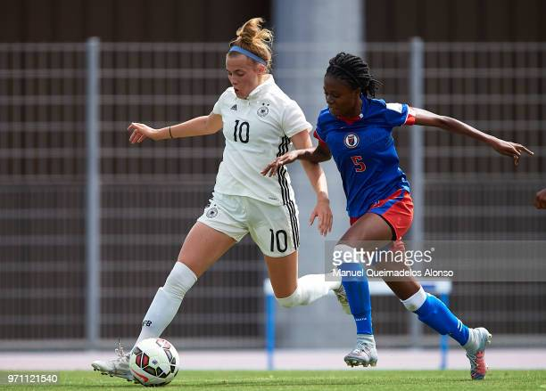 Laura Freigang of Germany competes for the ball with Nandie Deshommes of Haiti during the Four Nations Tournament match between U20 Haiti Women and...