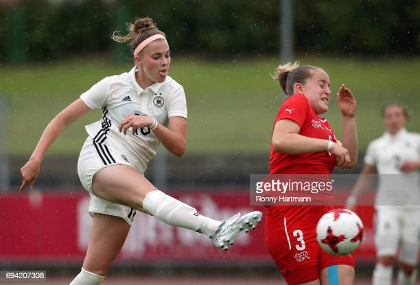 Laura Freigang of Germany competes with Annina Rauber of Switzerland during the U19 women's elite round match between Germany and Switzerland at...