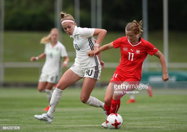 Laura Freigang of Germany competes with Nathalie Lienhard of Switzerland during the U19 women's elite round match between Germany and Switzerland at...