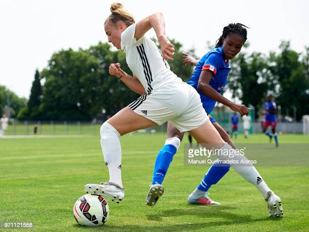 Laura Freigang of Germany is tackled by Nandie Deshommes of Haiti during the Four Nations Tournament match between U20 Haiti Women and U20 Germany...