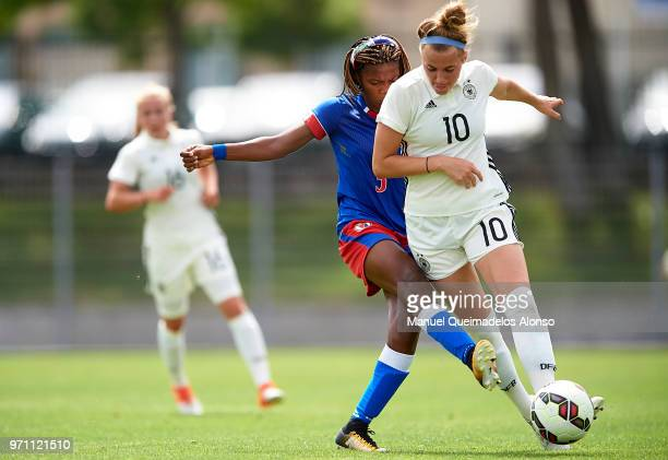 Laura Freigang of Germany is tackled by Naphtalie Northe of Haiti during the Four Nations Tournament match between U20 Haiti Women and U20 Germany...