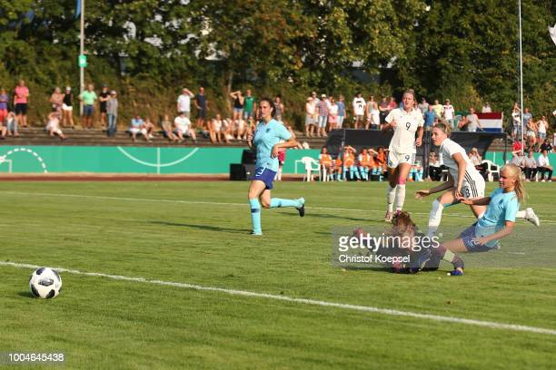 Laura Freigang of Germany scores the first goal against Life Kop and Jasmine Duppen of the Netherlands during the friendly match between Germany U20...