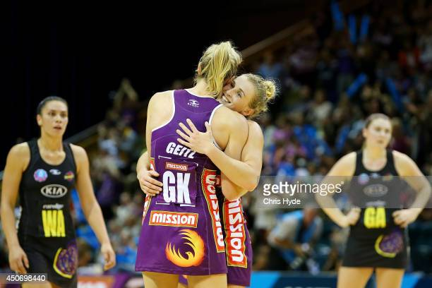 Laura Geitz and Gabi Simpson of the Firebirds celebrate winning the ANZ Championship Preliminary Final match between the Firebirds and the Magic at...