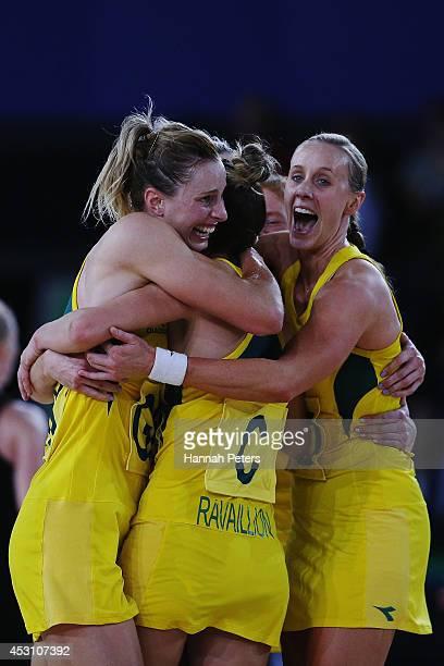 Laura Geitz Kimberley Ravaillion and Renae Hallinan of Australia celebrate winning the gold medal match between Australia and New Zealand at SECC...