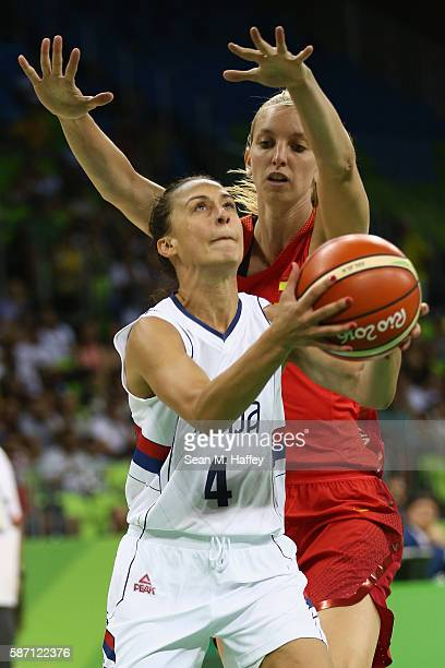 Laura Gil of Spain defends against Tamara Radocaj of Serbia during a Women's Basketball preliminary round game on Day 2 of the Rio 2016 Olympic Games...