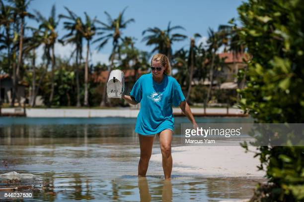 Laura Gilbert retrieves her father's condo mailbox from the water after it had been swept away by Hurricane Irma in Islamorada Florida Keys on Sept...