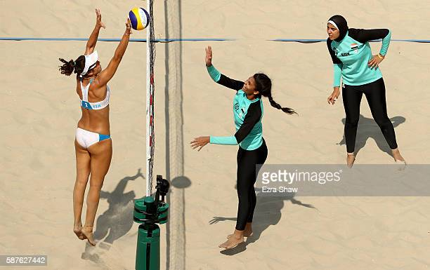 Laura Giombini of Italy and Nada Meawad of Egypt battle at the net during the Women's Beach Volleyball Preliminary Pool A match on Day 4 of the Rio...