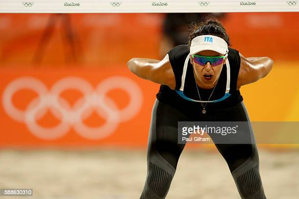 Laura Giombini of Italy looks on against Laura Ludwig and Kira Walkenhorst of Germany during the Women's Preliminary Pool D on Day 6 of the Rio 2016...