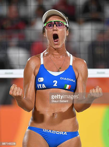 Laura Giombini of Italy reacts during the Women's Beach Volleyball preliminary round Pool D match against Jamie Lynn Broder and Kristina Valjas of...