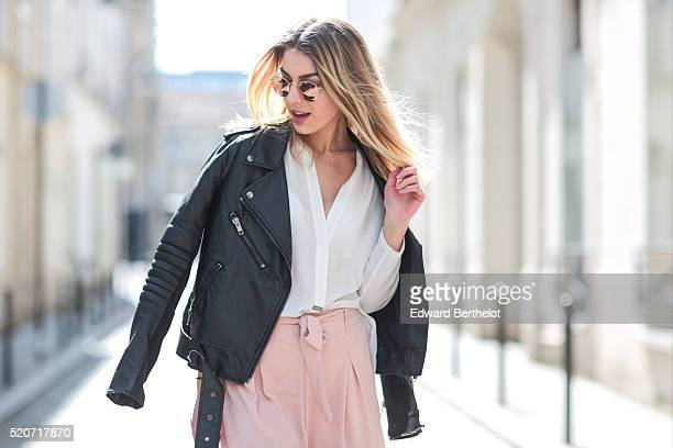 Laura Girard is wearing a Georges Rech white shirt Stradivarius pink pants a Zara black leather perfecto jacket Aldo black shoes and RayBan...