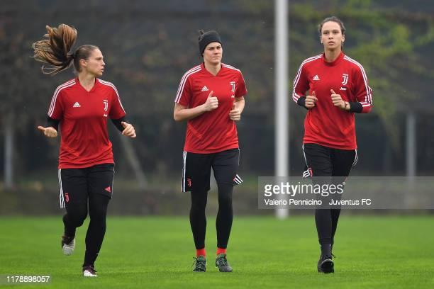 Laura Giuliani, Sabrina Tasselli and Doris Bacic of Juventus Women during a training session at Juventus Center Vinovo on October 29, 2019 in Vinovo,...